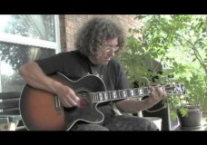 Ueli von Allmen on a guitar by Dixie Michelle